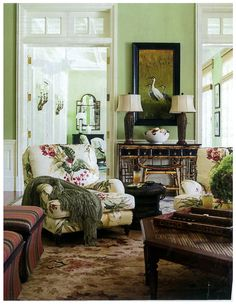 "Awesome Soft Avocado Green Space…In the family room of a Palm Beach Home, designer Allison Paladino painted the walls Benjamin Moore's Lewiville Green — the color of ""a very ripe avocado. Green Family Rooms, Family Room Walls, Living Room Green, Family Room Design, Green Rooms, Living Room Colors, My Living Room, Living Room Designs, Green Painted Rooms"