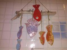 Pesciolini in terracotta per decorare il bagno