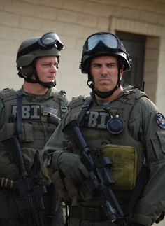 (t) LAUGHLIN AIR FORCE BASE, Texas – Two members from S.W.A.T team with the FBI from San Antonio remain on scene after the a apprehension of hostage-takers during a base exercise Dec. 11. (U.S. Air Force photo by Airman 1st Class Sara Csurilla) #swat