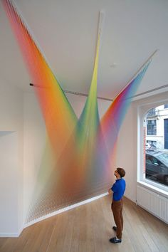 Thousands of colored sewing threads create amazing rainbow effect in these art installations by Mexican artist Gabriel Dawe.