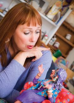 Little Rock, Ark., artist Jane Hankins with a sculpture of Rhonelle Dubois