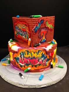 Graffiti and Glow themed 2-tier cake perfect for your next Glow Party at Stratum!