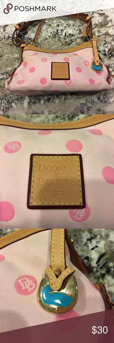 PARTY ONLY SALE! Authentic Dooney and Bourke purse Super cute pink with polka dots, this is a lovely little purse! It has barely been used, but please notice the small stain spots as pictured hence the deep discount. Dooney & Bourke Bags Mini Bags