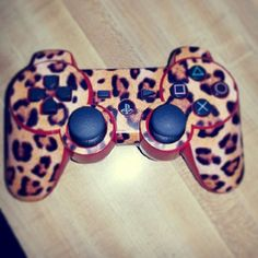 Leopard print PS3 controller stickers.