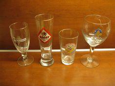 Four original glasses: 1 x Adler; 1 x Gauloise; 1x Amstel; 1 x Leffe...