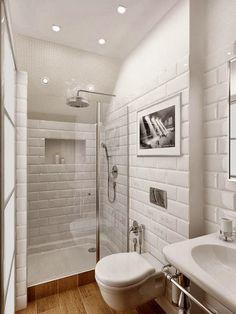 Baño pequeño. azulejos de rectangulos blancos... me encanta!!! foto blanco y negro, detalles color plata. Si! esto quiero!