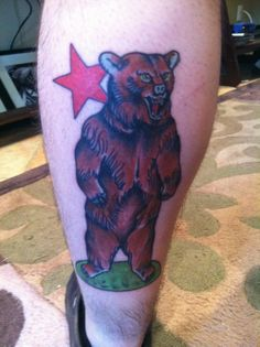 standing bear tattoo with red star on leg - http://tattoosaddict.com/standing-bear-tattoo-with-red-star-on-leg.html #bear, leg, on, red, standing, star, star tattoo, tattoo, with