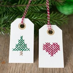 Cross stitch on manilla tags for Christmas. Tutorial in English and Swedish.