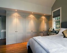 Style of Fitted Wardrobe. Would ideally mirror the style of cabinet in En-Suite.
