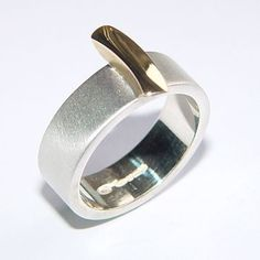 Silver band with18ct gold detail | Contemporary Rings by contemporary jewellery designer Paul Finch