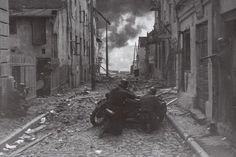 German advance unit street-fighting in a polish town, 1939. This one was staged for the war correspondent.
