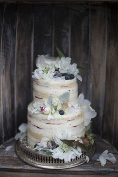 rustic naked wedding cake with fresh flowers