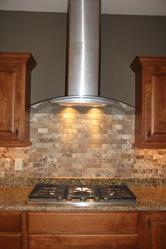 Custom Kitchen With Granite Countertops Stainless Steel Range Hood And Marble Backsplash Description From