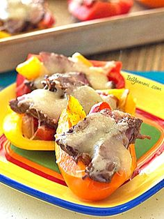 Steak Fajita Bell Pepper Sliders Recipe - Tender steak, onions, spices and melted cheese, all tucked into sweet bell peppers. Perfect appetizer or after school snack.