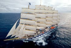 This is the Royal Clipper Cruise ship, a (obviously) sailing cruise ship, which tours both the Mediterranean and the Caribbean. It makes the transatlantic crossing (upwind) in 16 days, which seems pretty remarkable to me. Sailing Cruise Ship, Sailing Ships, Sailing Cruises, Bridgetown, Tall Ships, Royal Clipper, Tall Ship Cruises, Boat Wallpaper, Guinness World