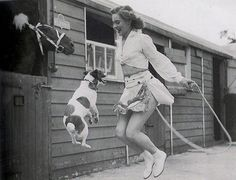 lady jumping rope with a dog while a horse watches! so cool!