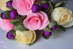 Pink roses ivory flowers little purple ball flowers bouquet
