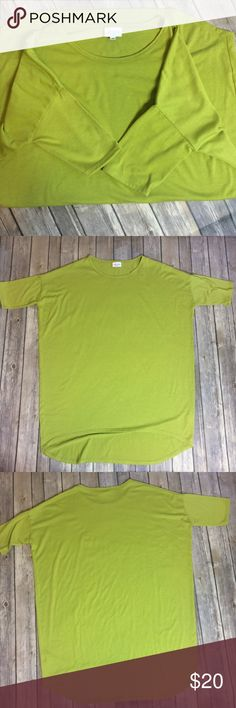 LulaRoe Irma Pea Green Solid Irma Tee Size S LulaRoe Irma Solid Pea Green Tee. Size S. Excellent condition. Irma tees are supposed to fit loose, please refer to pictures for measurements! LuLaRoe Tops Tees - Short Sleeve