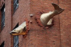 Transcendence ~ artist Keith Jellum, c.1998. South Park Building Seafood Grill at 901 Southwest Salmon Street and Ninth Avenue, Portland, Oregon. 11 feet (3.4 m) long, hand forged & welded bronze The inspiration for this piece came from migrating salmon on the Columbia River at Celilo Falls, an ancient traditional Indian fishing site. When the Dalles Dam was built in 1957, it flooded the area & the Falls were submerged. #art #sculpture