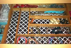 use a flatware tray to organize your jewelry