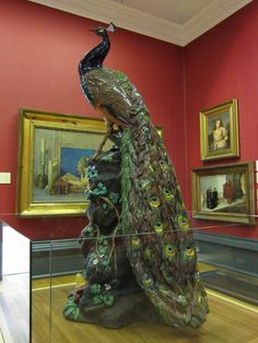 Minton made twelve of these peacocks in the 1870's and only nine are known to survive. This example has been roosting in the Walker gallery in Liverpool since 1891. It is made from earthenware majolica and it was modelled in 1873 by Paul Comolera. It was fired all in one piece, which makes it a major technical achievement as well as an artistic one, given that it is about four feet tall.