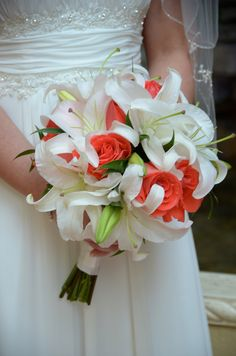 Beach wedding hand-tied bridal bouquet of white casablanca lilies and coral roses, design by Sunshine Wedding Company, Destin beach weddings, photo by Tamra Turner