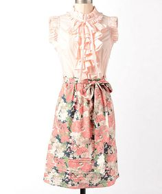 Full of feminine charm, this vintage-inspired dress boasts a soft floral print, flattering tie waist and delicate ruffles. The barely-there cap sleeves complete the look of this flawless frock.100% cottonMachine wash; dry flatImported