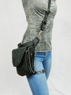 Turn heads with the Black Leather Warrior Pack! This sexy holster functions 8 different ways and easily handles your firearm. Stop lugging around your purse and let the Black Leather Warrior Pack do the work for you…and look HOT while doing it!