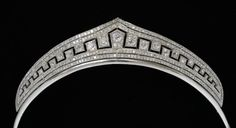 An early art deco diamond tiara, with an unusual, quasi-meander motif