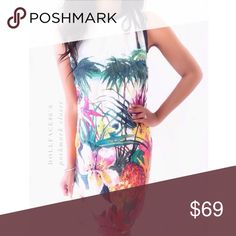 """Juicy Couture Silk Tropical Shift Dress This dress has a beautiful tropical pattern on its silk pattern with a neckline that ties for a darling retro feel  •chest:17"""" •waist:16.5""""w •length:34""""  Material:100%silk  ️️️️️️️️️️️️️️️️️️️️️️️️️Dry clean  Fit:like med/sml Condition:no rips no stains black trim in neckline a little faded in color ❌no holds ❌no trades ♥️️bundles of 3/more items get 20% off🎊🎊 Juicy Couture Dresses"""