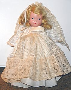 This is a 1940s all bisque nancy ann storybook doll that is all