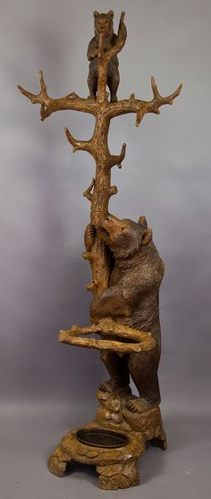 Another Beautiful Black Forest Carved Bear Hall Tree. Photo via ebay.  Oh How I wish I were rich right now !!! LOL