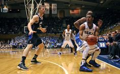 Behind 21 points from Jabari Parker and 18 from Rodney Hood, Duke routed UNC-Asheville 91-55 Monday night at Cameron Indoor Stadium.