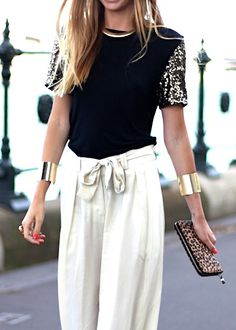 Love the bangles & of course the leopard clutch, wonder what kind of shoes she's wearing................