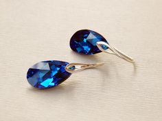 Bridesmaids Swarovski Capri blue drop dangle earrings Crystal deep dark blue pear shape sterling silver earrings by DreamyBox on Etsy https://www.etsy.com/listing/224522842/bridesmaids-swarovski-capri-blue-drop