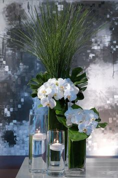 White orchid with green palm leaves tropical wedding centerpieces ideas