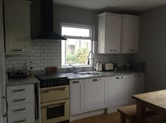 The finished kitchen...chic blanco tiles from Topps Tiles
