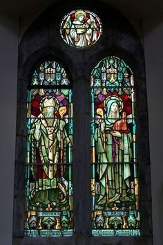 """Saint Brigid and Saint Patrick were """"one heart and one mind"""" (click link to read) Picture: Stained glass windows of Saints Patrick and Brigid, the two premier saints of Ireland, in Saint Joseph's Church at Clifden, Ireland. Photo by James Yardley."""