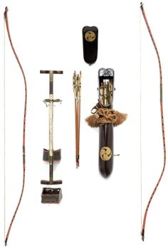 Yumi-dai (archery stand) comprising a wooden shaft with brass and tooled leather mounts, with two bows of black lacquer bound with red-lacquered rattan bands, 119.5cm (47in); the utsubo (quiver) of roiro, lacquered in gold hiramakie with mitsu-tomoe mon containing ten bamboo-shaft arrows with gold and black lacquer details.
