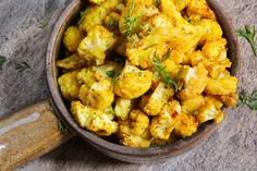This rich, hearty cauliflower side dish with zesty Moroccan seasoning can also be served as a vegetarian main course. Cauliflower Side Dish, Oven Roasted Cauliflower, Cauliflower Curry, Cauliflower Recipes, Roasted Chicken, Gobi Recipes, Curry Recipes, Vegetarian Main Course, Vegan Vegetarian
