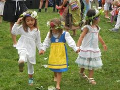 Girls with flower wreaths at Swedish Midsummer Festival celebration in New York.