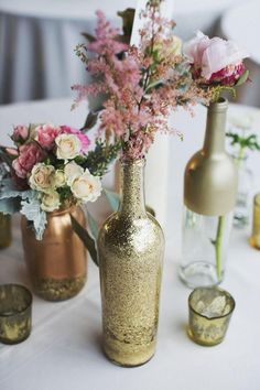Vintage Wedding Ideas With Pink Flowers and Gold and Brown Bottles Details for Wedding table
