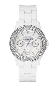 Smaller white watch designed by Michael Kors well suited for a smaller frame as it is classy, glamorous and more delicate