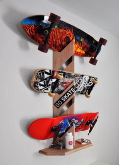 Skateboard Display Rack by woodwaze on Etsy, $45.00 Cool looking skateboard/snowboard rack! @ sharkracks.com