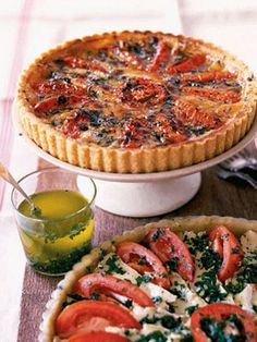 A flaky pastry crust plays host to Gruyère and Camembert cheeses, sliced plum tomatoes, and a fragrant herb oil in this showstopping savory tart.Recipe: Tomato and Camembert Tart Easy Brunch Recipes, Easter Dinner Recipes, Romantic Dinner Recipes, Dinner Ideas, Easter Dinner Menu, Romantic Dinners, Easter Brunch, Summer Recipes, Meal Ideas