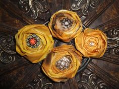 A very popular fabric rosette with this cool mustard bronze hand rolled fabric!! Gently frayed to give it a vintage feel and you choose the embellishment!
