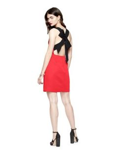 this simple sheath boasts a bow-bedecked back and a nipped-in waist for a look that's simultaneously chic and a little bit sweet; pair it with a jacket and sling-backs for a meeting, or try stacked heels when you want to dance all night.