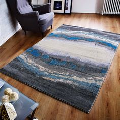 This stunning and awesome looking rug is all you need this Christmas to uplift your decor in style. #abstractrugs #bluerugs #largerugs #designerrugs #durablerugs #modernrugs #affordablerugs