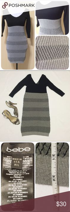 """Bebe Bodycon Dress Stylish & comfortable: A hard combination to find! This bodycon dress is more fitted/clingy than tight making it super comfy & more forgiving! 3/4 sleeves, ribbed black bodice and a gray/black skirt. Size says M/L; it'd fit a large but is perfect for medium. Length 32.5"""". Bust, hips & waist super stretchy. bebe Dresses"""