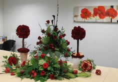 Level 2 students- Carman rose composite bouquet and buttonhole, topiary trees, pedestal and large table design. Students Sarah Oliver and Lindsey Raven. Peterborough